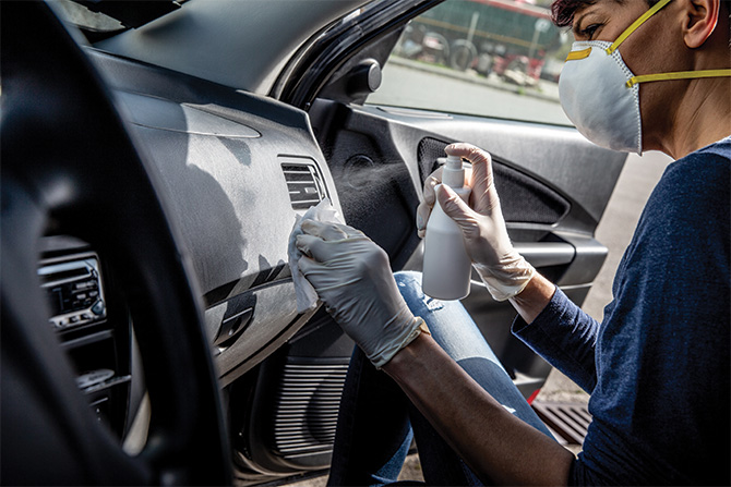 woman-cleaning-car